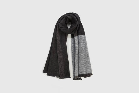 Silky white wool woven across light ombre graduating grey stripes to form a gorgeous large, light super soft scarf made of 100% Merino wool