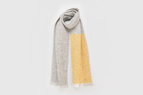 Grey fleck interwoven with vibrant yellow 100% Merino wool to form a light twill super soft scarf handmade in Dingle