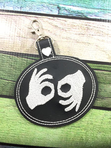 ASL Sign Language interpreter snap tab - Backpack/Keyfob tag embroidery design