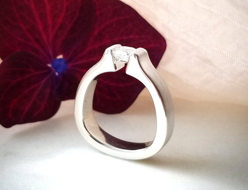 Contemporary Concept Tension Diamond Engagement Ring