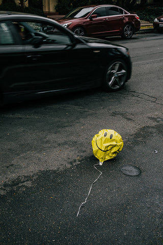 smiley balloon on road