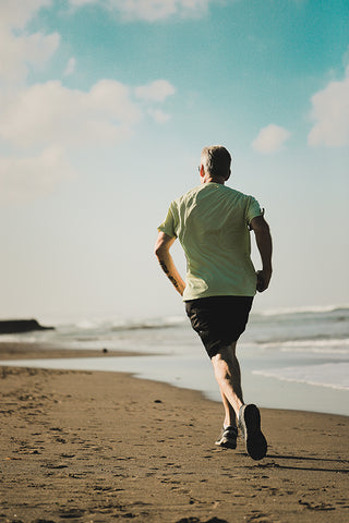 man running along the beach