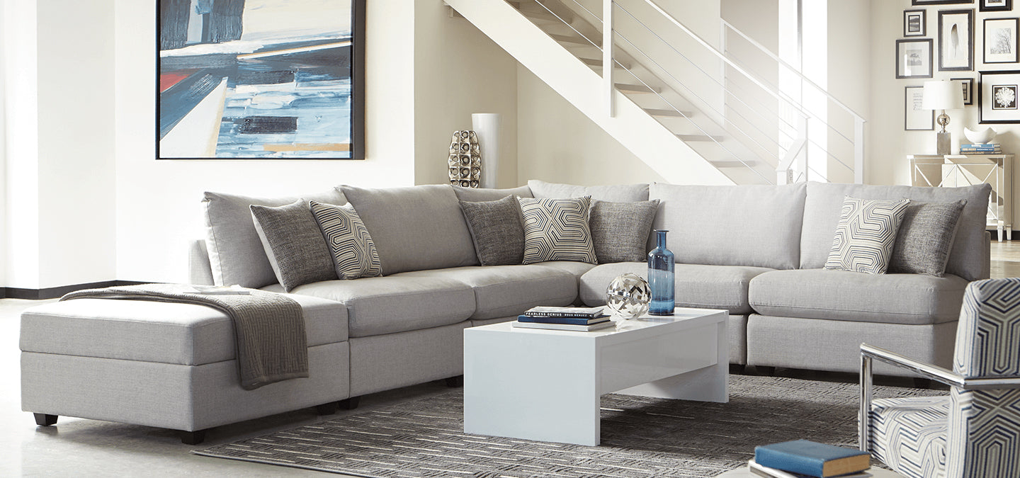 Scott Living sectional sofa in living room with decorative pillows