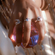 Sterling silver retro rings holding a crystal ball
