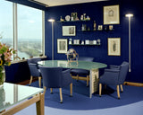 Smart office with big window, painted in midnight blue
