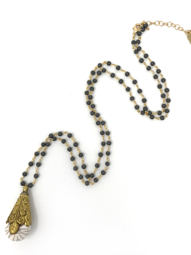 Hematite Beaded Chain with a Tibetan Howlite Pendant - Necklace