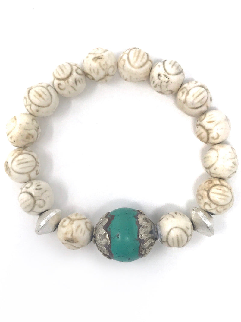 Carved 10mm Howlite with Turquoise Tibetan Focal Bead Bracelet