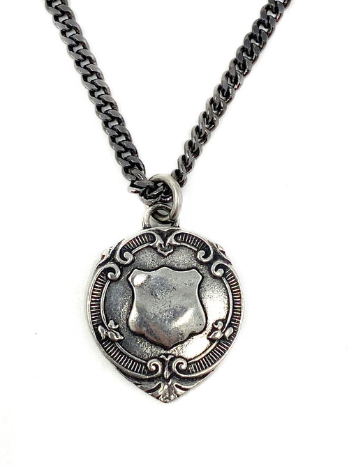 Silver Crest Pendant on Dark Silver Curb Chain