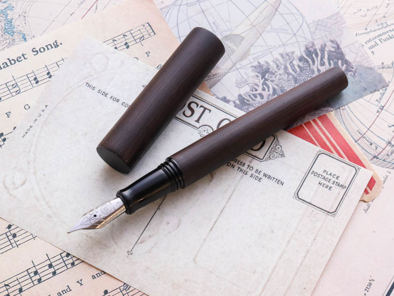 Ebony wood fountain pen with Wancher 18k gold nib.