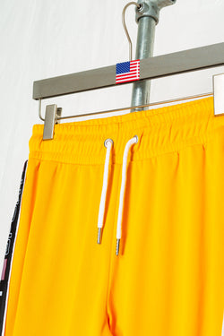 SOCIETY SPORT YELLOW TAPED POLY PANTS