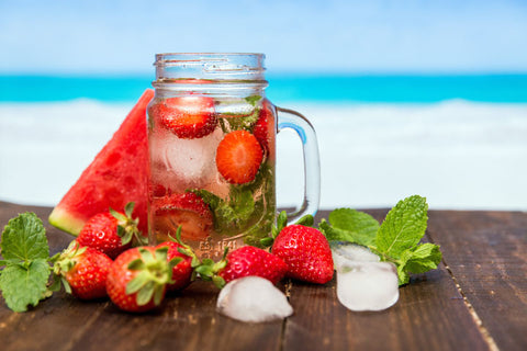 Berries and water in mason jar with watermelon
