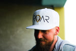 ROAR - SIGNATURE SERIES FLAT BILL - WHITE WITH BLACK/GOLD SNAPBACK