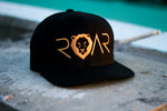 ROAR - SIGNATURE SERIES FLAT BILL - BLACK AND GOLD SNAPBACK