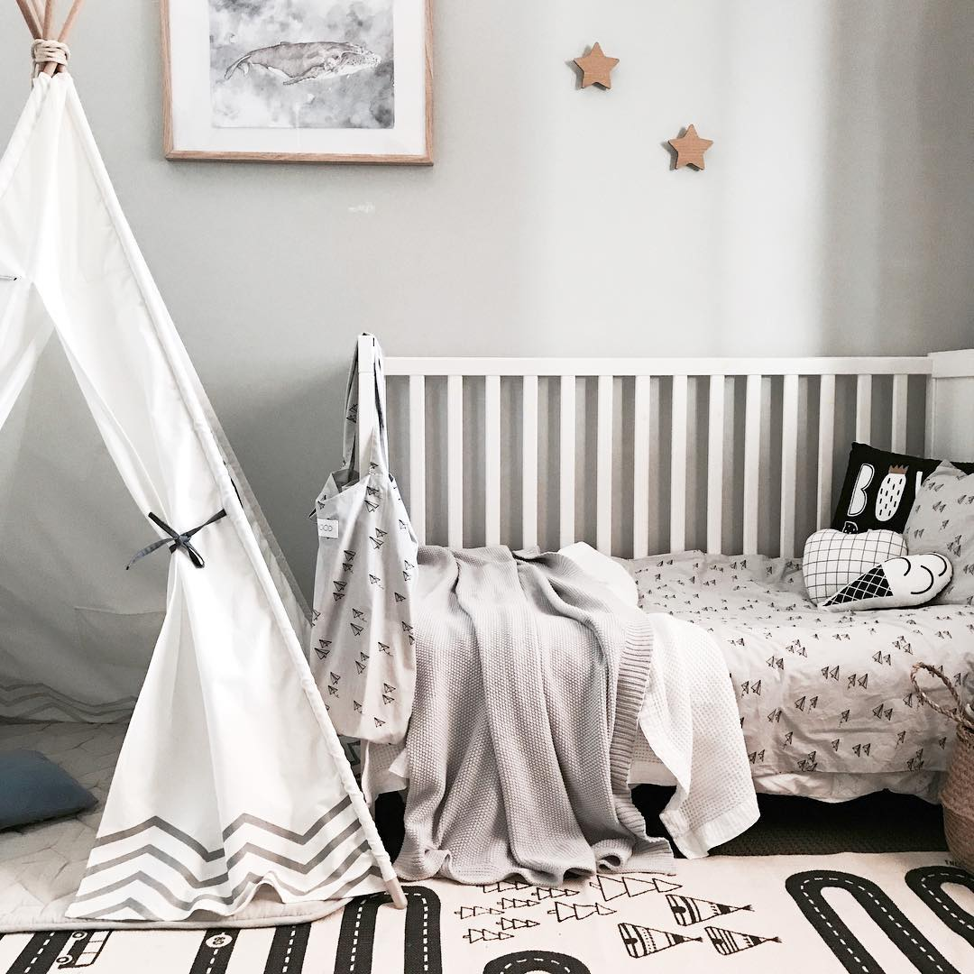 scandi kids room with humpback whale art print made from watercolour and teepee in monochrome boys nursery