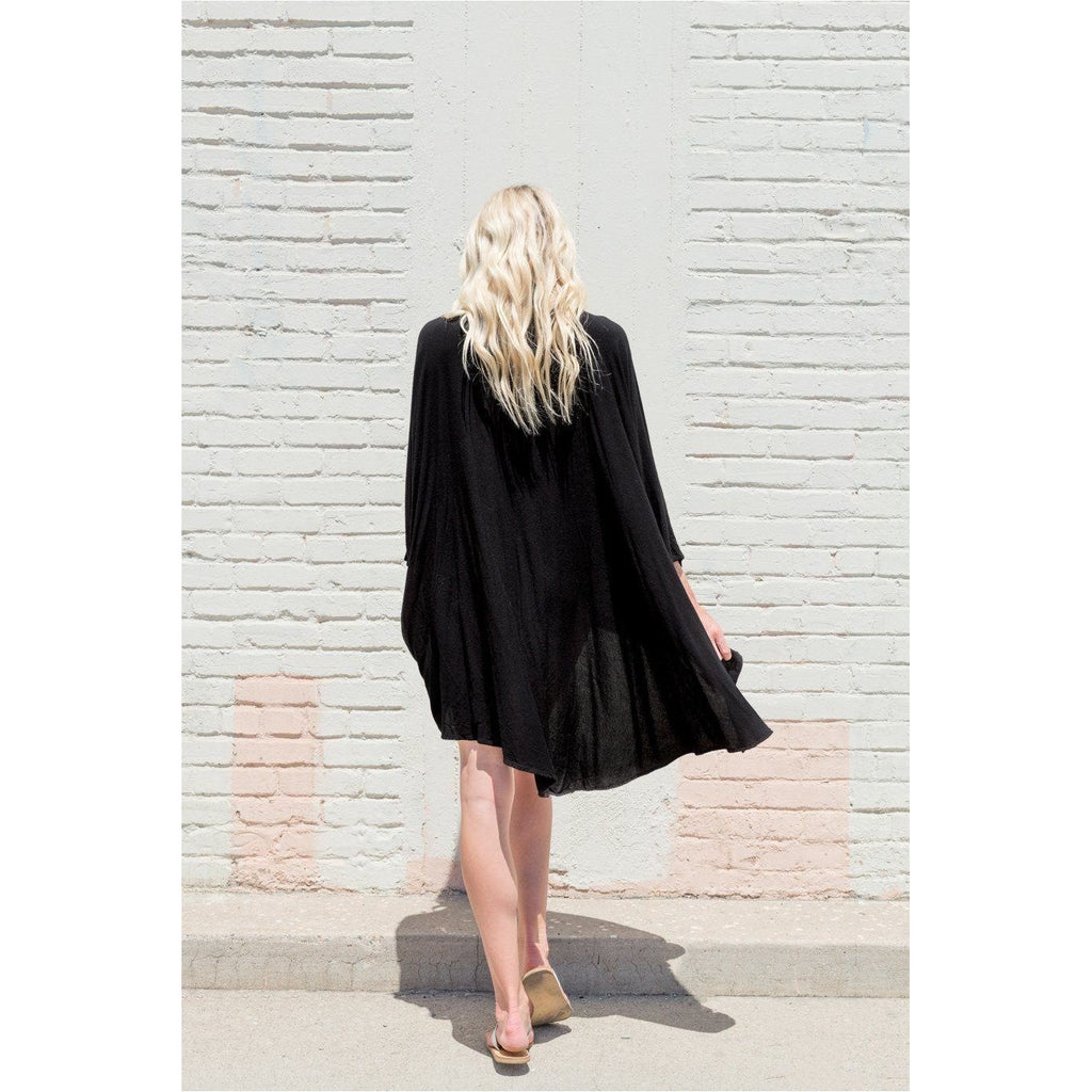 Black Hooded Dress Top. Back view