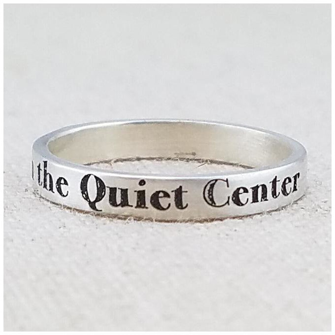 silver ring with breathe in the quiet center inscribed