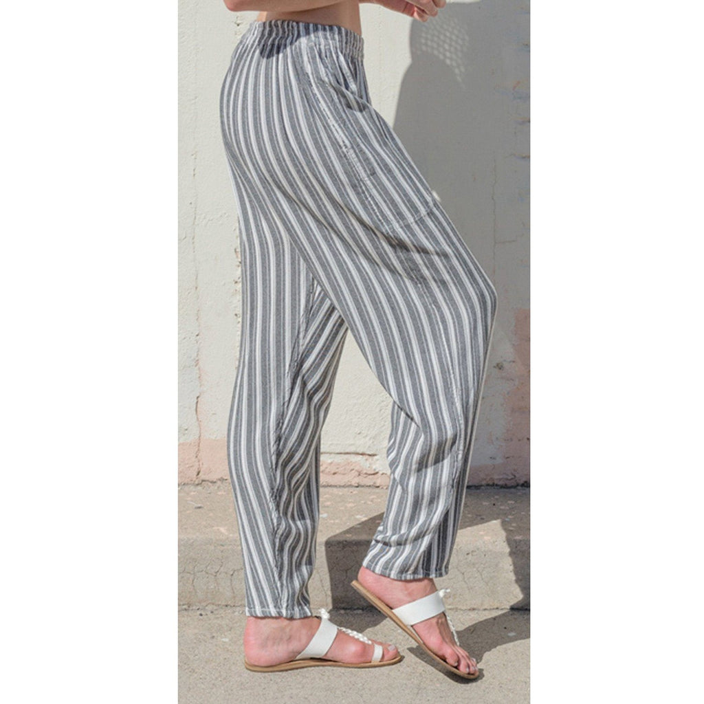 Striped tapered pants. Side view.