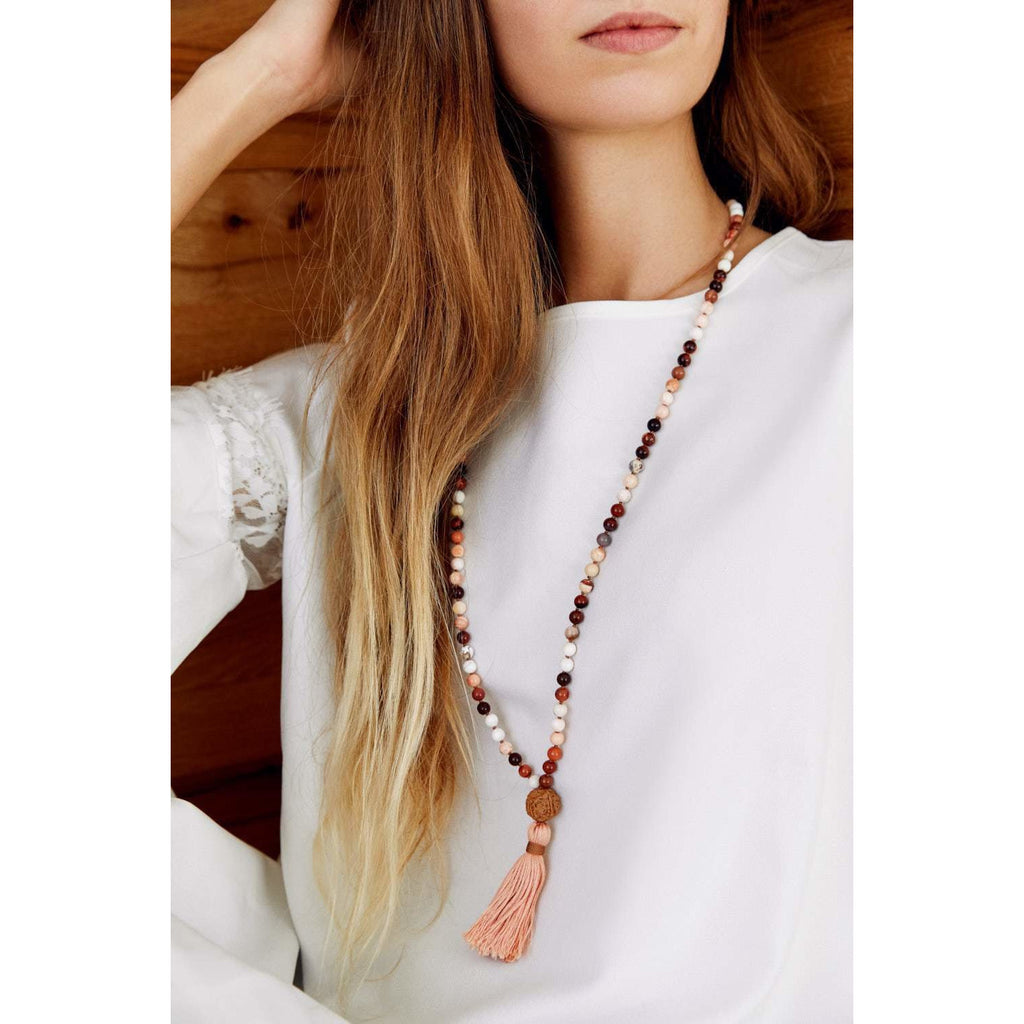 fire opal mala on woman