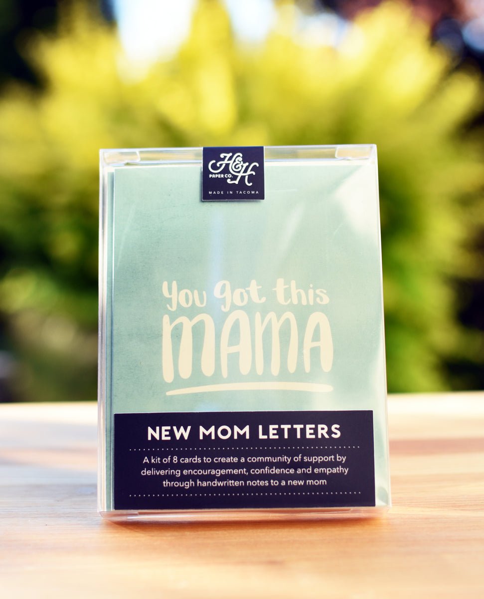New Mom Letters packaging on a wooden table