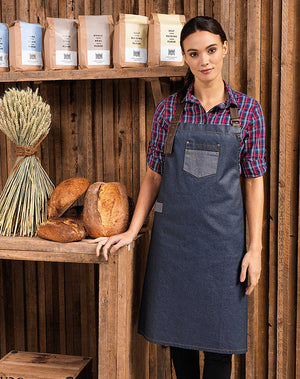 Model wearing the Division Waxed-Look Denim Bib Apron with Faux Leather