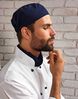 Chef wearing the Chef's Skull Cap