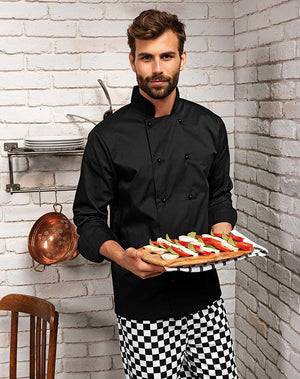 Chef wearing the Cuisine Long Sleeve Chef's jacket