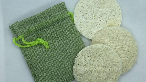 Pack of Loofah Facial Pads and a small bag