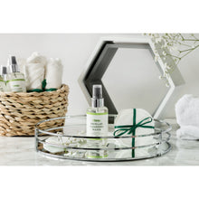Micellar water and cotton pads on dressing table