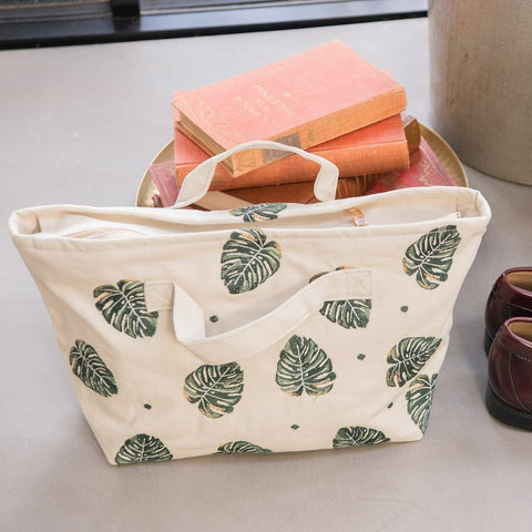 Soft canvas travel bag in Jungle Leaf pattern in natural colour - with books