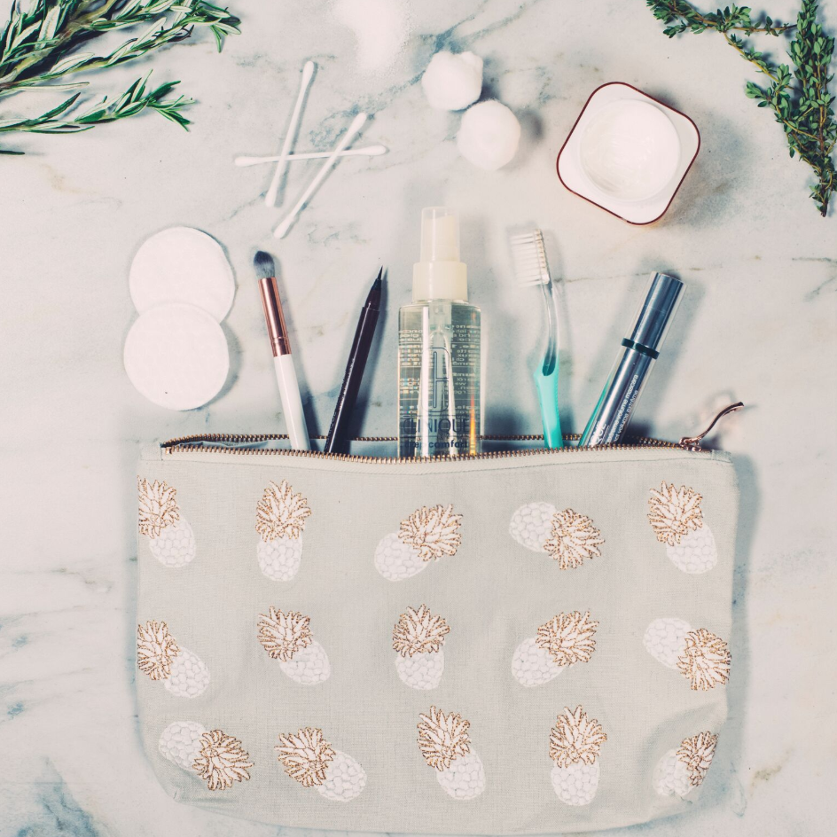 Soft canvas travel pouch in cloud Ananas pineapple pattern with makeup