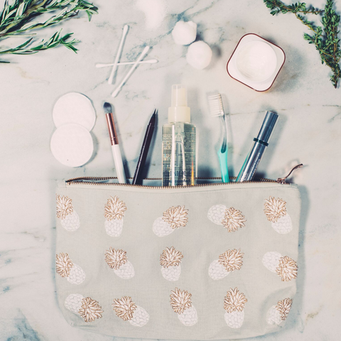Image of Soft canvas travel pouch in cloud Ananas pineapple pattern with makeup