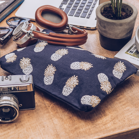 Soft canvas travel pouch in indigo Ananas pineapple pattern on desk