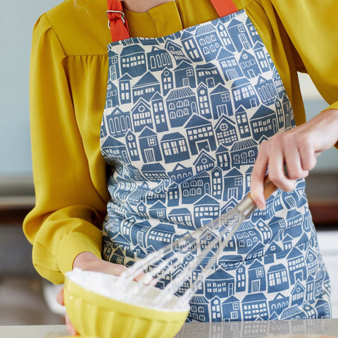 Apron for cooking or baking in bold About Town print on a model