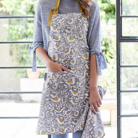 Apron for cooking or baking in bold Grey Doves print on a model