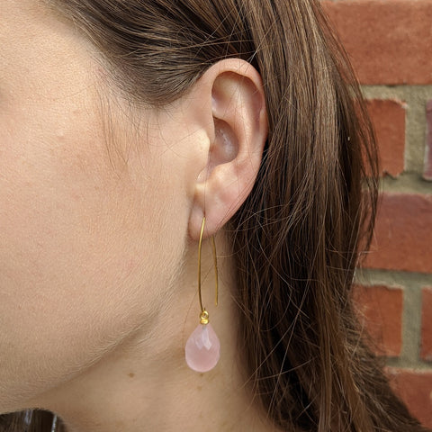 Arabella wishbone drop earrings with teardrop pink quartz gemstone on model