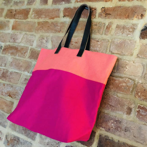 Image of Bright handmade canvas shopper bag in orange & fuchsia with comfortable leather handle - hanging