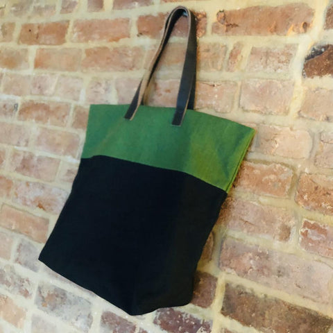 Bright handmade canvas shopper bag in green & black with comfortable leather handle - hanging