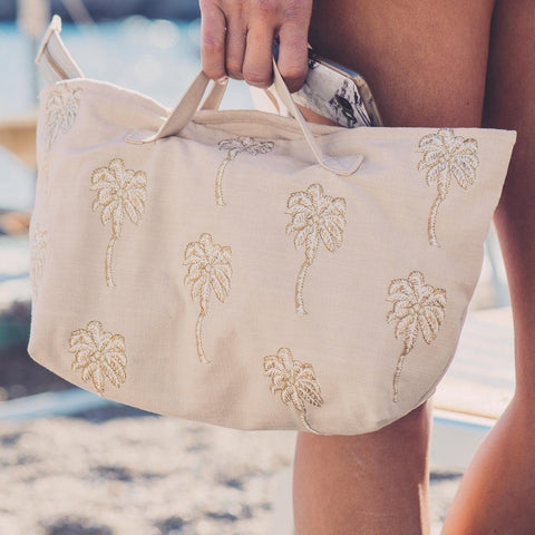 Soft canvas travel bag with embroidered Palmier or palm tree pattern in taupe with model