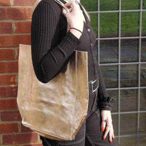 Spacious genuine Italian leather shopper bag with metallic rose gold finish on a model