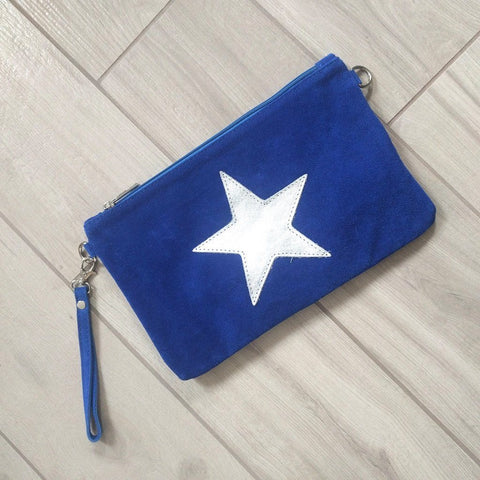 Image of Italian suede leather clutch bag with shiny metallic leather star in blue