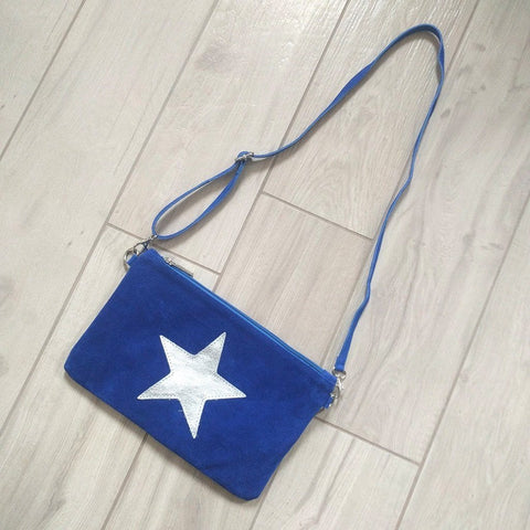 Image of Italian suede leather clutch bag with shiny metallic leather star in blue with long strap