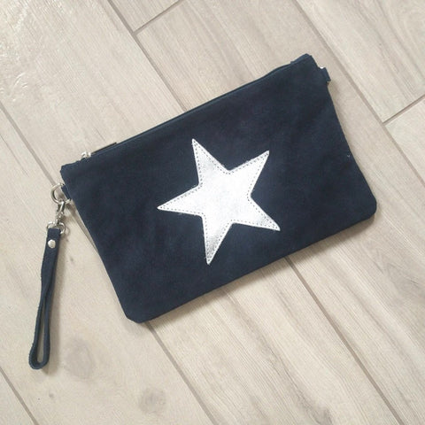Image of Italian suede leather clutch bag with shiny metallic leather star in navy