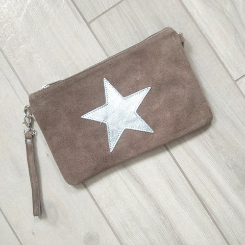 Image of Italian suede leather clutch bag with shiny metallic leather star in taupe