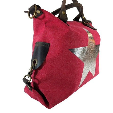 Vintage look canvas and genuine leather bag with shiny metallic star in fuchsia with handles and a detachable long strap