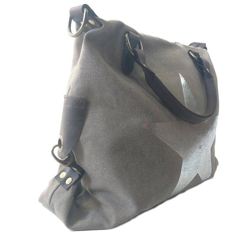 Vintage look canvas and genuine leather bag with shiny metallic star in taupe with handles and a detachable long strap