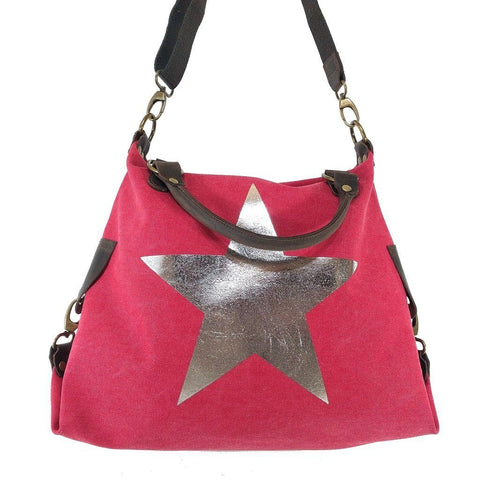 Vintage look canvas and genuine leather bag with shiny metallic star in fuchsia on long strap