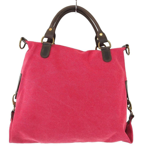 Vintage look canvas and genuine leather bag with shiny metallic star in fuchsia - rear view