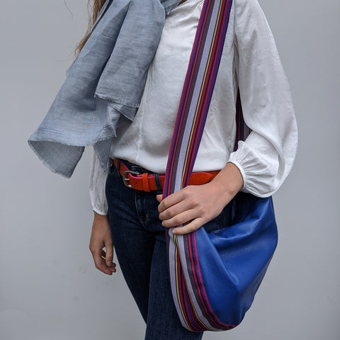 Image of Band shoulder bag in soft blue leather on model