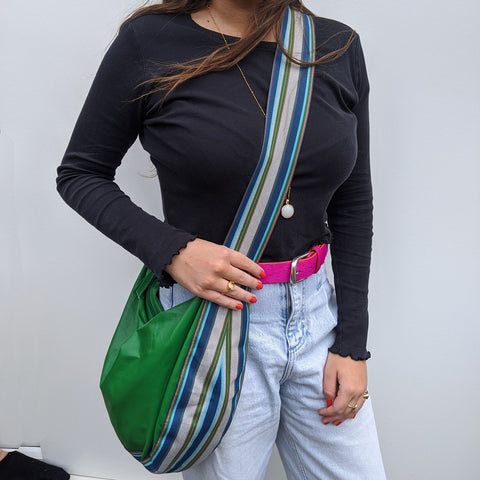 Image of Band shoulder bag in soft green leather on model