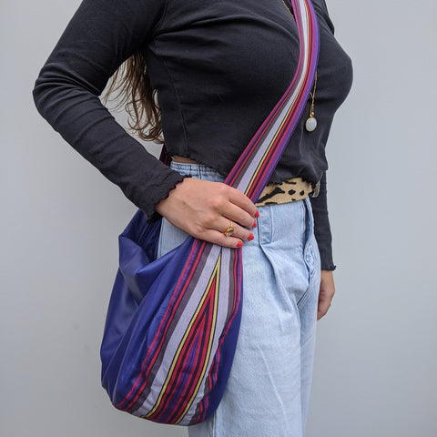 Band shoulder bag in soft lavander leather on model